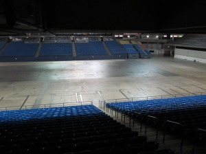 Top rows of lower bowl shadowed by overhang